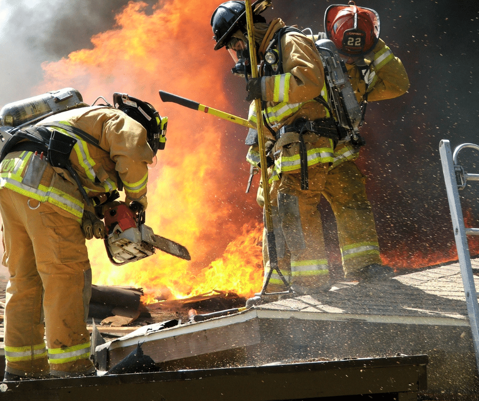 firefighters using chainsaws
