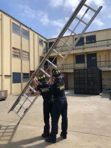 Image of two WFPA participants maneuvering a ladder
